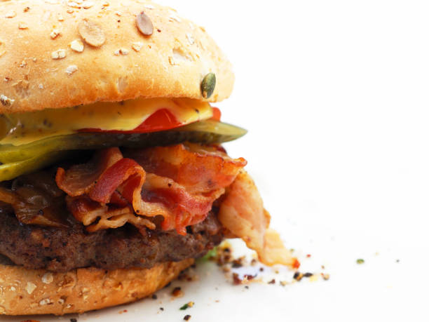 Part delicious burger with bacon isolated on white background Part delicious burger with bacon isolated on white background bacon cheeseburger stock pictures, royalty-free photos & images