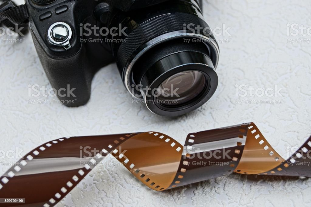 part of a black camera and a piece of brown film stock photo