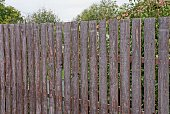 istock part of a brown fence from wooden boards 1181499906