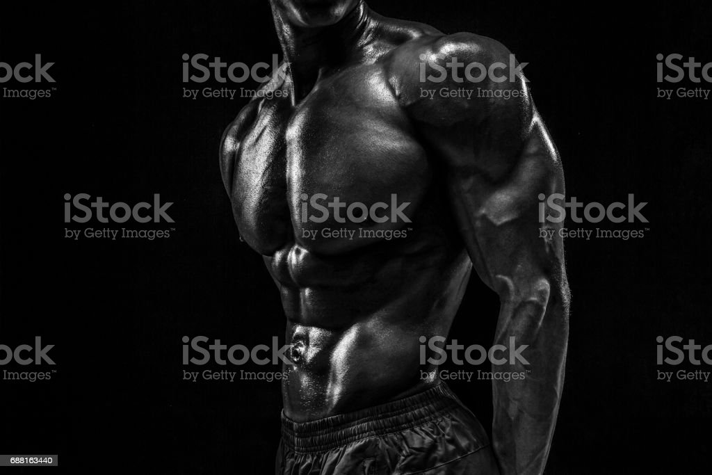 Part of a man's body on a dark background with copyspace stock photo
