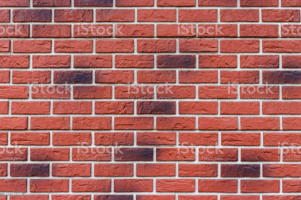 Part of a red brick wall. stock photo