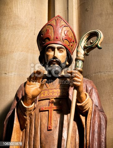 Part of a large wooden carving of St Nicholas in St Nicholas' Church, Wells-next-the-Sea in Norfolk, Eastern England. St Nicholas is the patron saint of mariners.
