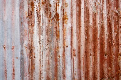 Rusted corrugated iron fence