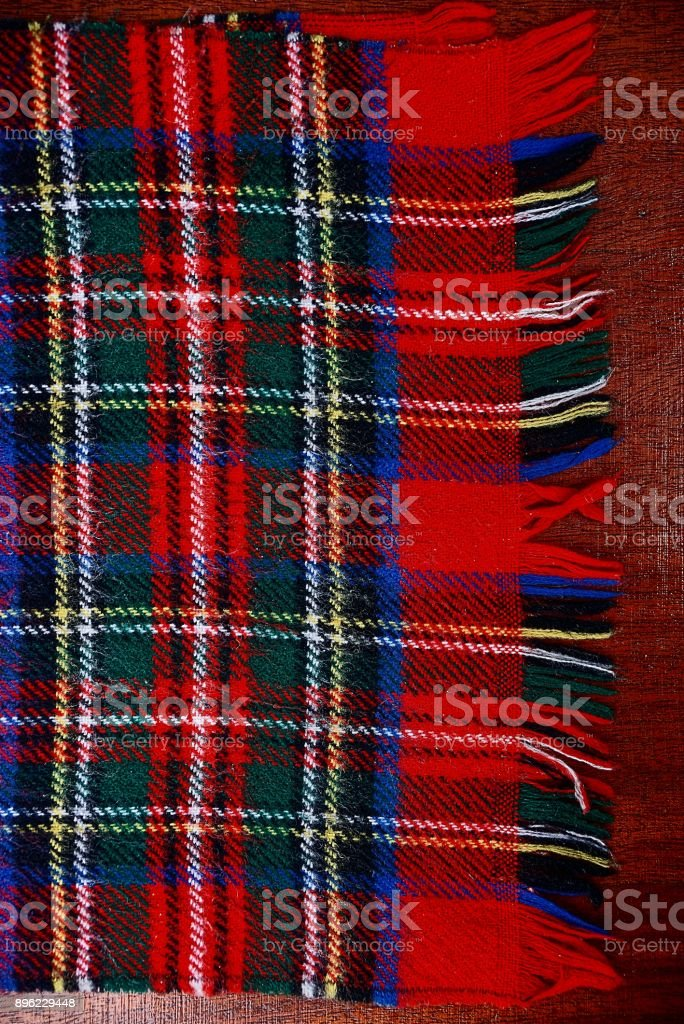 part of a scarf of bright colored woolen cloth stock photo
