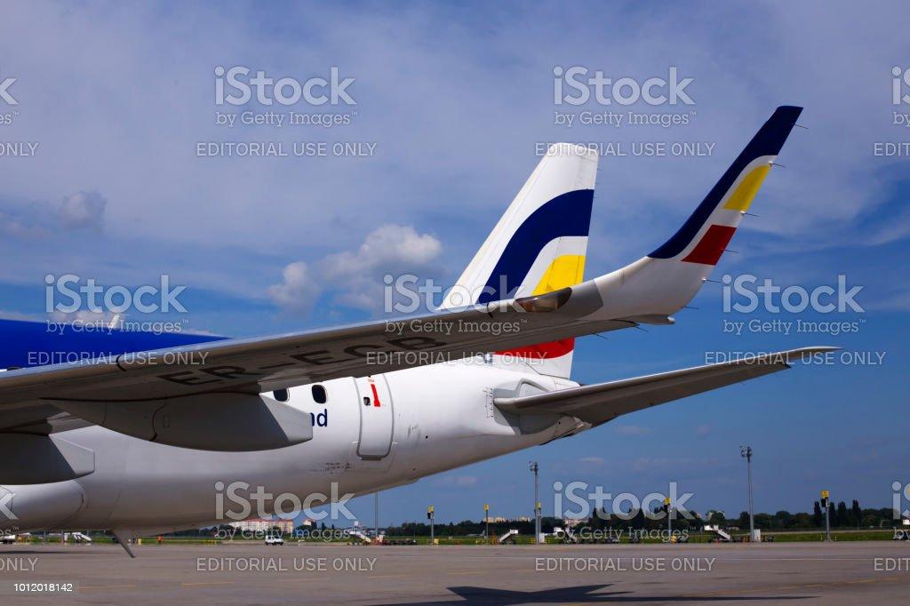 A part of Air Moldova Embraer ERJ-190 aircraft with logo stock photo