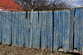 istock part of blue wooden old fence on rural street 1138371341