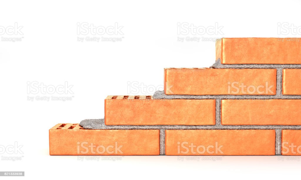 Part of brick wall in construction process on a white background stock photo
