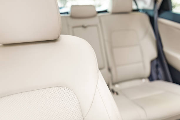 part of bright leather car seat. - car interior stock photos and pictures