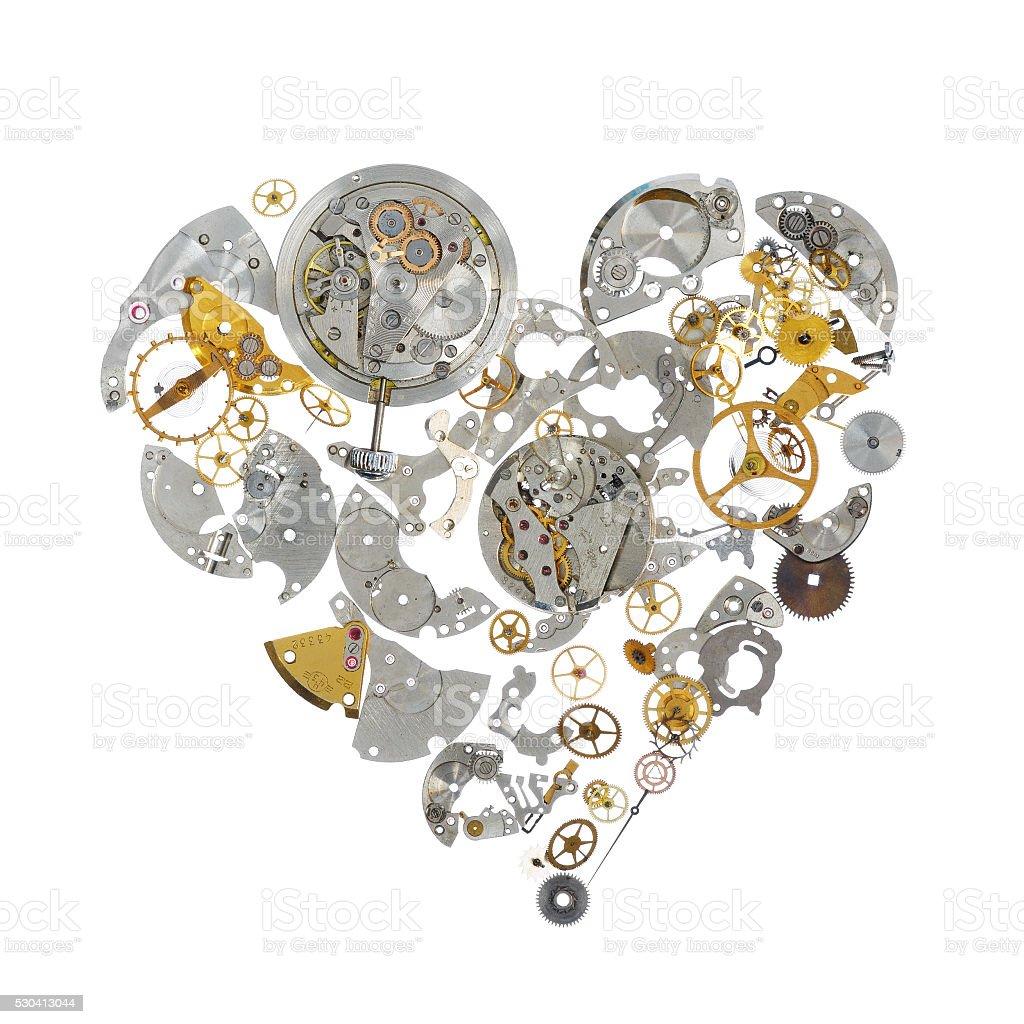 Part of broken watch shaped as heart stock photo
