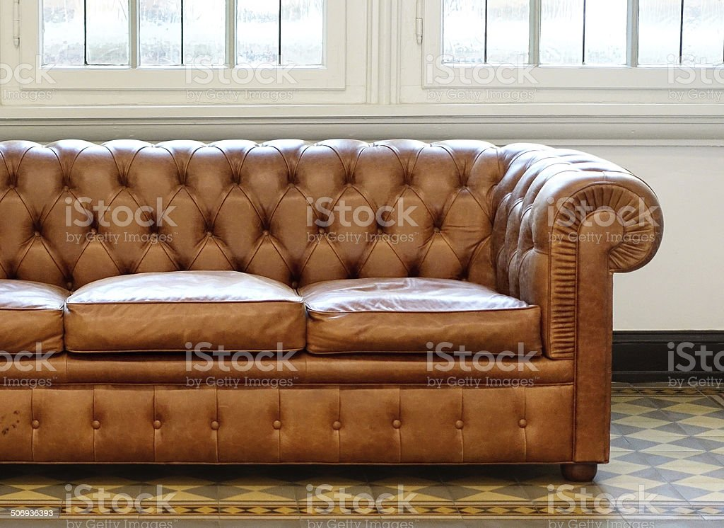 Part of brown Old Leather Couch stock photo