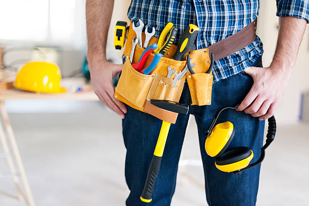 part of construction worker with tools belt - tool belt stock photos and pictures