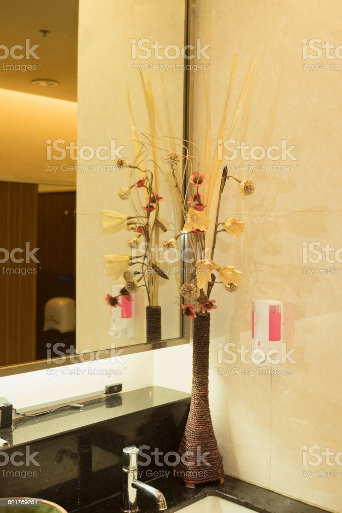 Part of decoration corner inside public washroom. Interior design stock photo