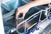 istock Part of dishwasher filter in male hand 1266433706