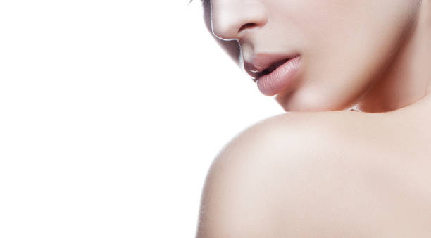 Part of face and shoulder of young model girl with perfect skin Lips, shoulder, girl face natural nude make-up. White background. Facial treatment concept nude women pics stock pictures, royalty-free photos & images