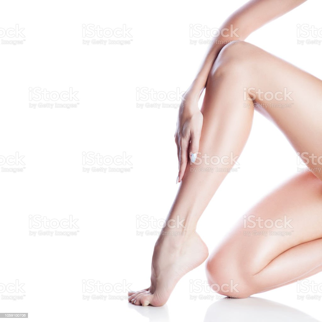 Girl leg. Smooth skin, hand with manicure nails. Copy space....