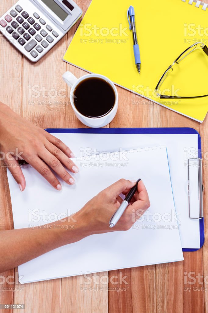 Part of hands taking notes foto stock royalty-free