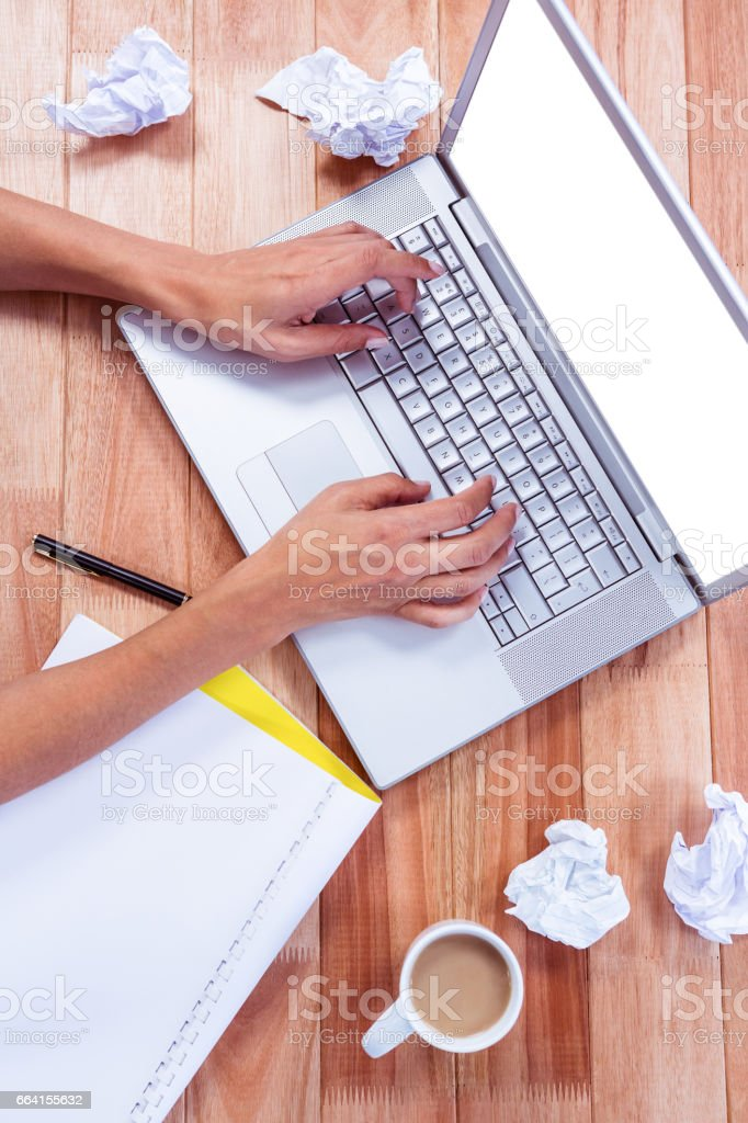 Part of hands typing on laptop foto stock royalty-free