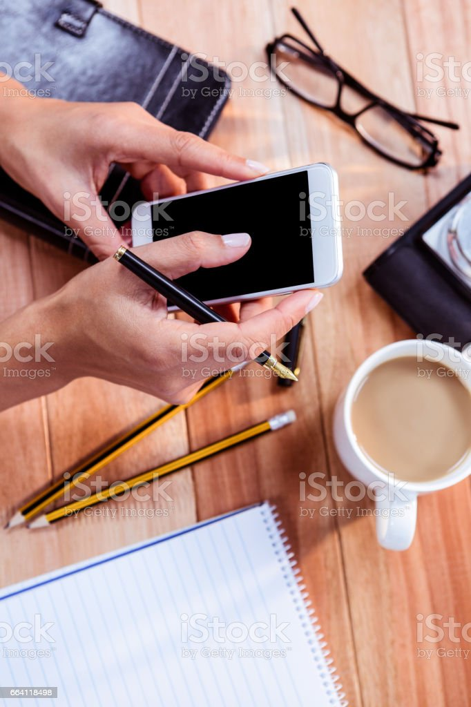Part of hands typing on smartphone foto stock royalty-free
