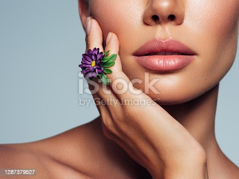 Part of human face with flower. Human nose and lips.