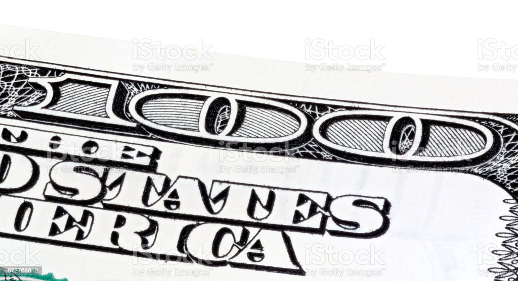 Part of hundred dollar banknote, stacked photo stock photo