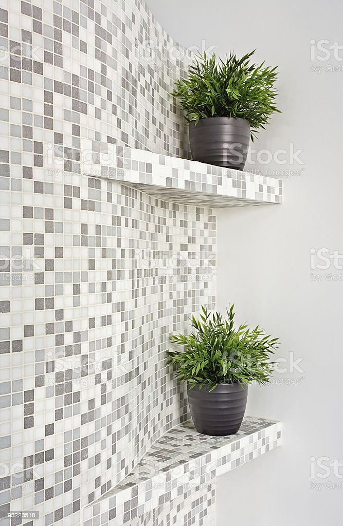 Part of interior with mosaic and green plants royalty-free stock photo