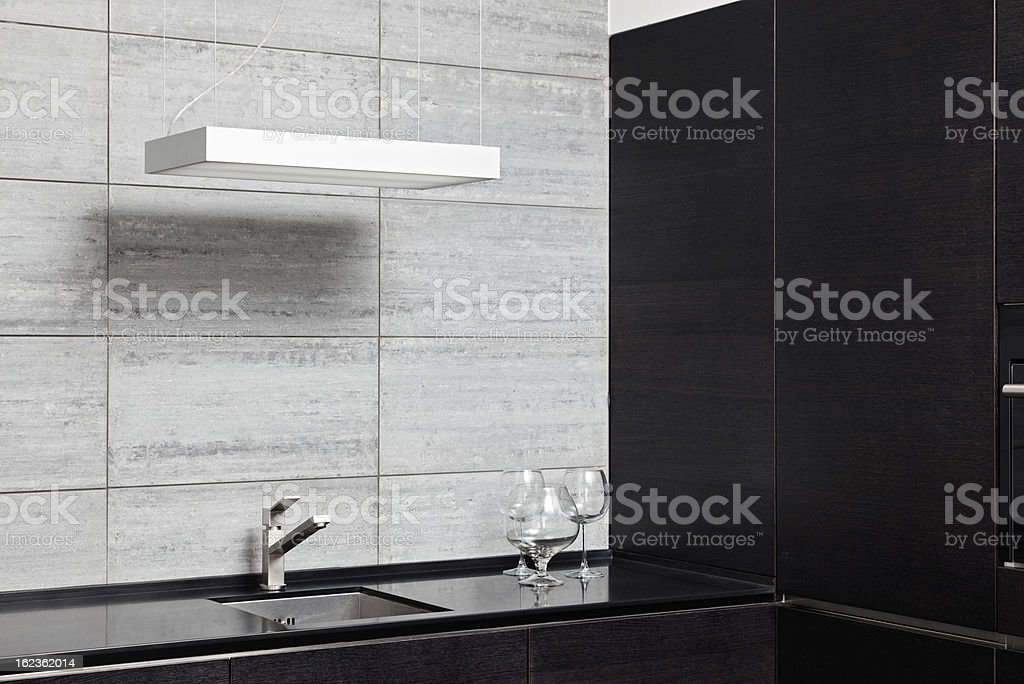Part of modern kitchen interior with sink royalty-free stock photo