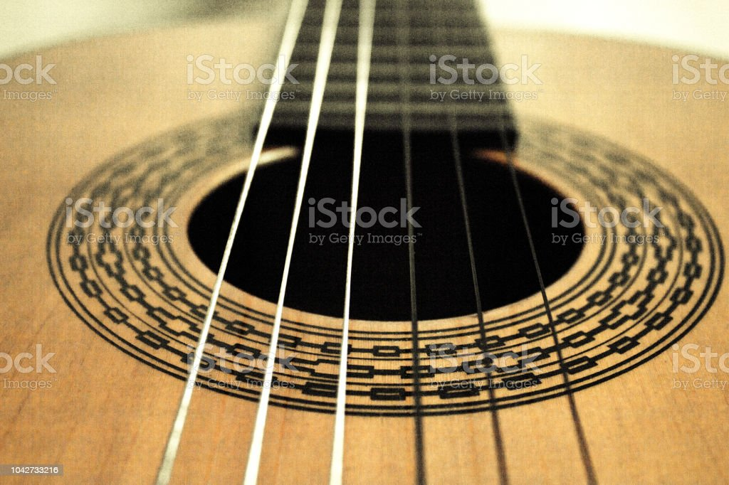 Part of musical instrument with strings. Spanish guitar stock photo