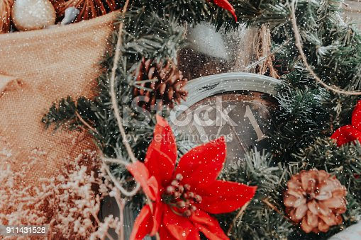 istock part of old clock, plastic leaves and  plastic red flower in vintage tone and snow effect 911431528