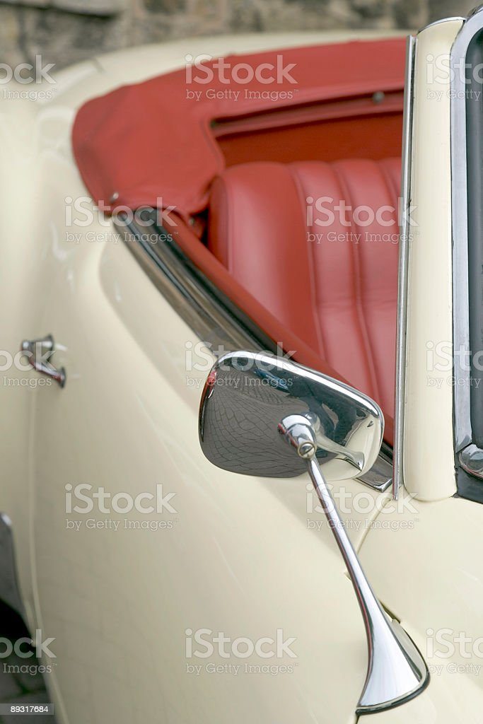 Part of old white vintage convertible with red leather seats stock photo