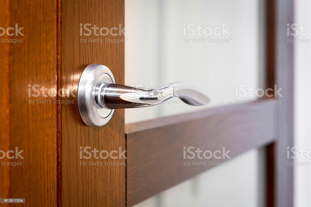 Part of open door with silver door-handle – Foto