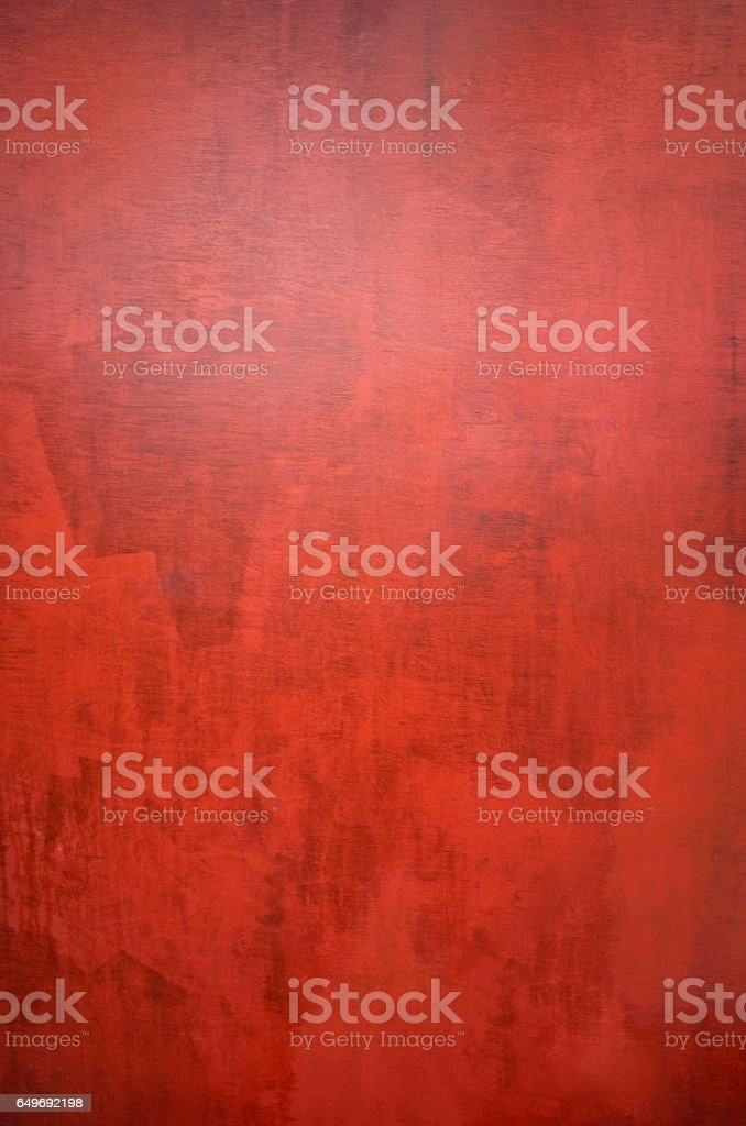 Part of red painted plywood textured by time stock photo