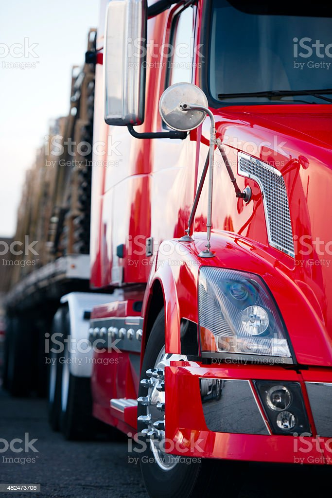 Part of semi truck modern red cabin trailer on parking stock photo