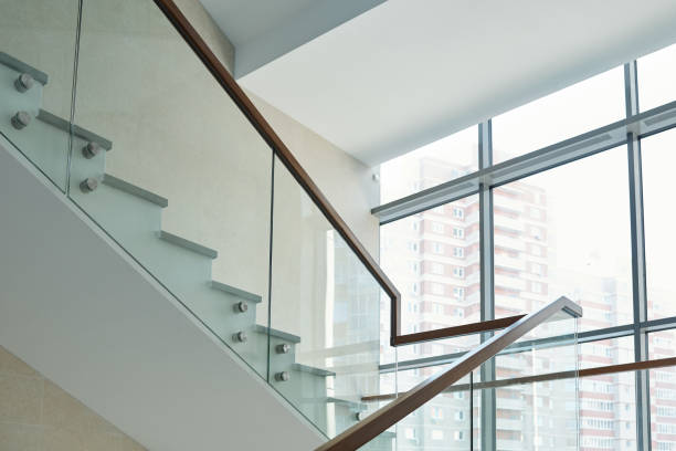 Part of staircase with railings and large window inside new business center stock photo