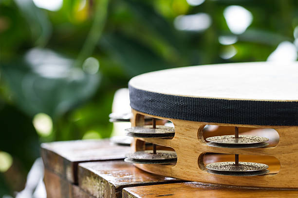 part of tambourine tambourine on wood table in garden nicoya peninsula stock pictures, royalty-free photos & images