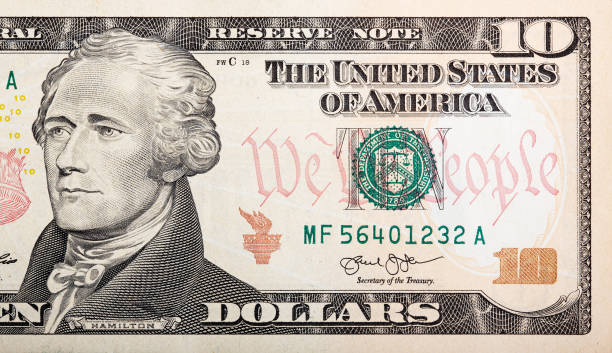 Part of ten dollar bill American money Part of ten dollar bill American money. High resolution photo. debt ceiling stock pictures, royalty-free photos & images