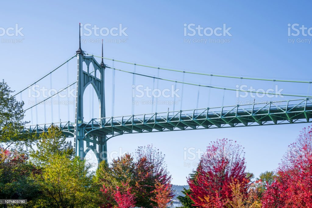 Part of the arched St Johns bridge in Portland in the colors of autumn trees stock photo