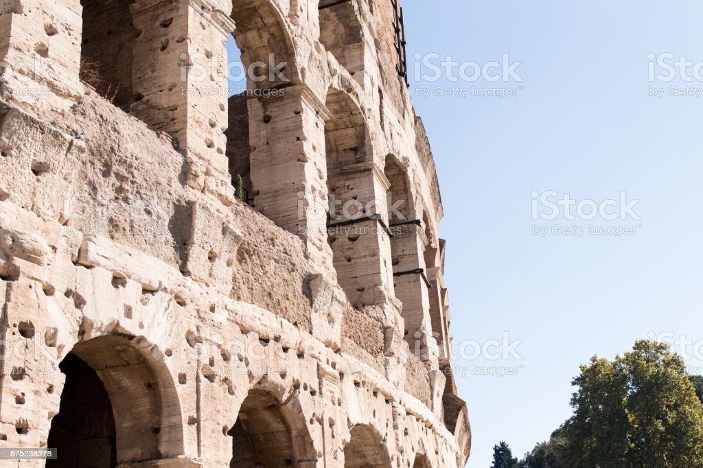 Part of the Colosseum in Rome with some arches in detail stock photo