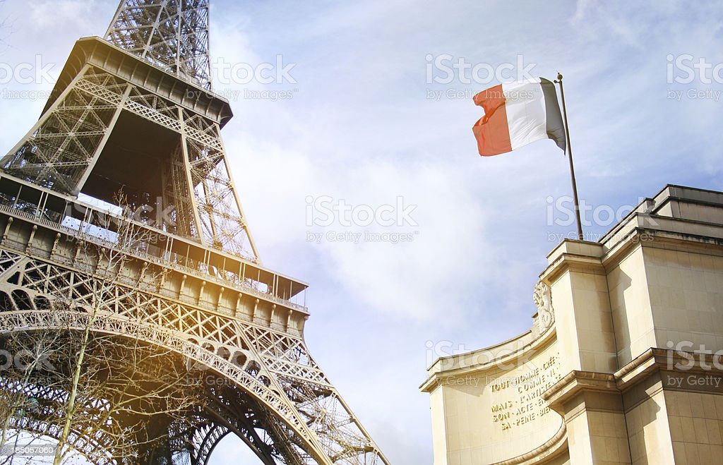 Part of the Eiffel Tower in Paris with French flag royalty-free stock photo