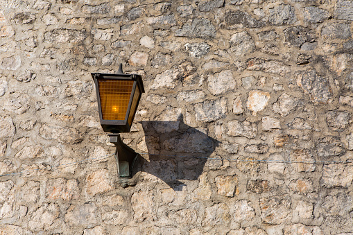 part of the fortress wall with lanterns in Herceg Novi