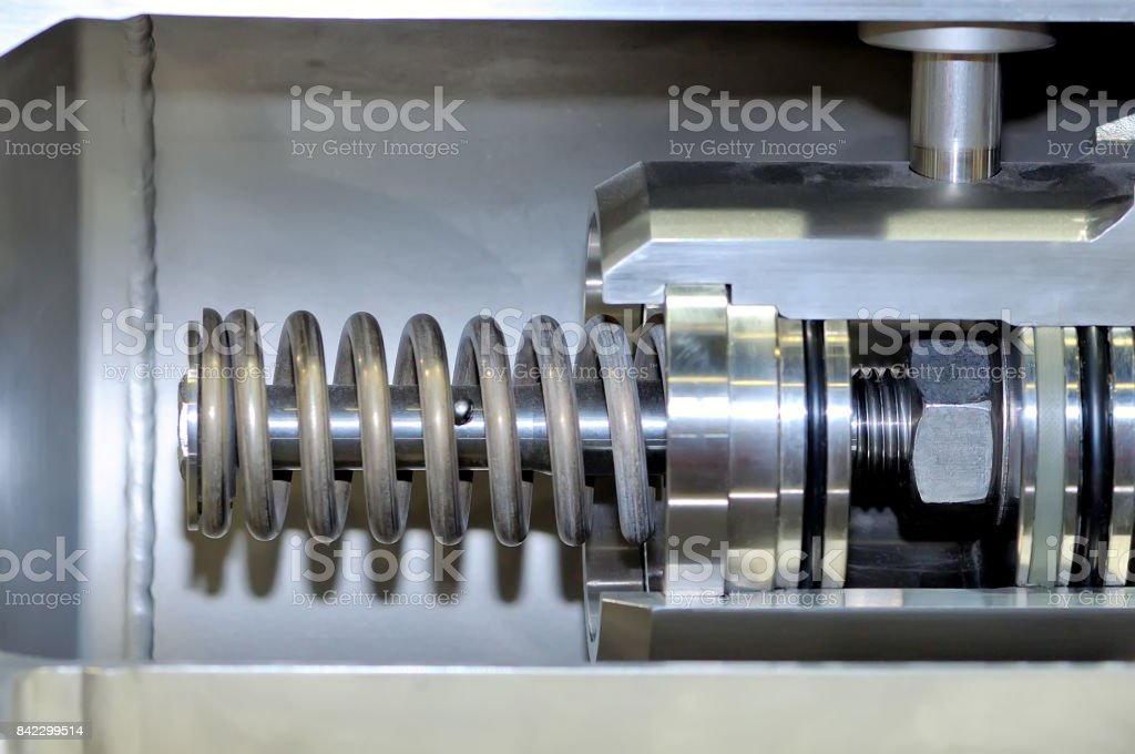 Part of the industrial mechanism with a metal spring stock photo