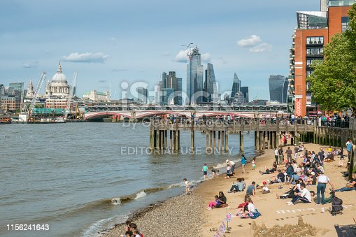 Part of the London (UK) skyline as seen from Gabriel's Pier. An urban beach in the foreground. In the background St. Paul's cathedral, Blackfriars Bridge and The Shard (high rise building)