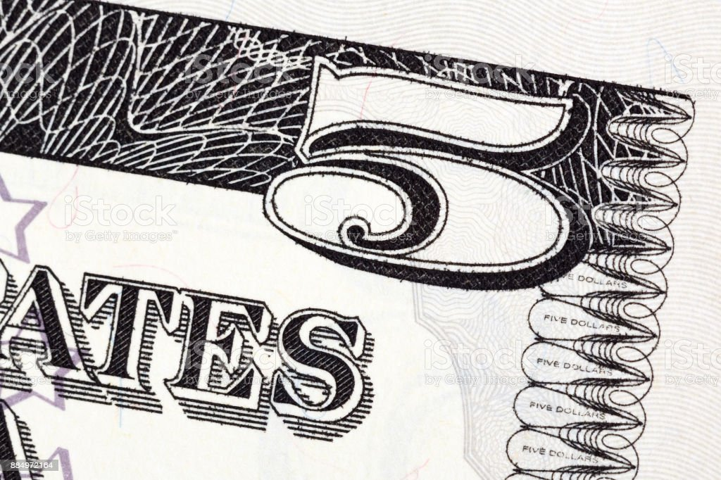 Part of the U.S. five dollar bill stock photo