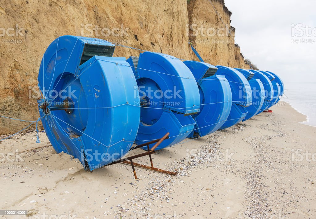 Part of the wave power station on the shore. Alternative energy. stock photo