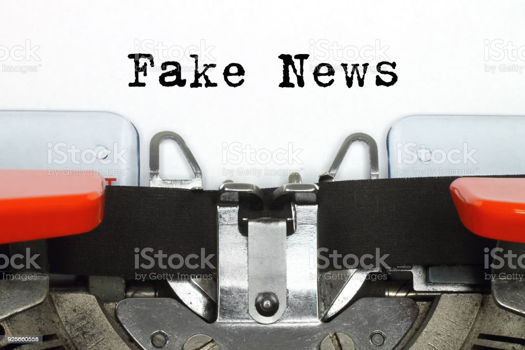 Part of typing machine with typed Fake News words stock photo