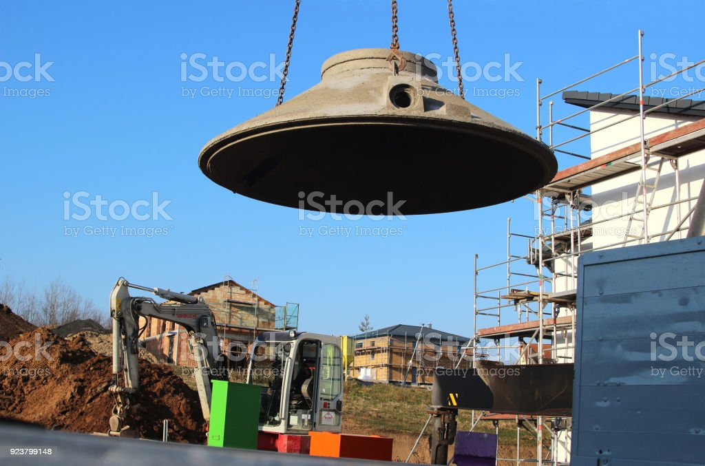 part of water cistern being lifted from a truck with a crane stock photo
