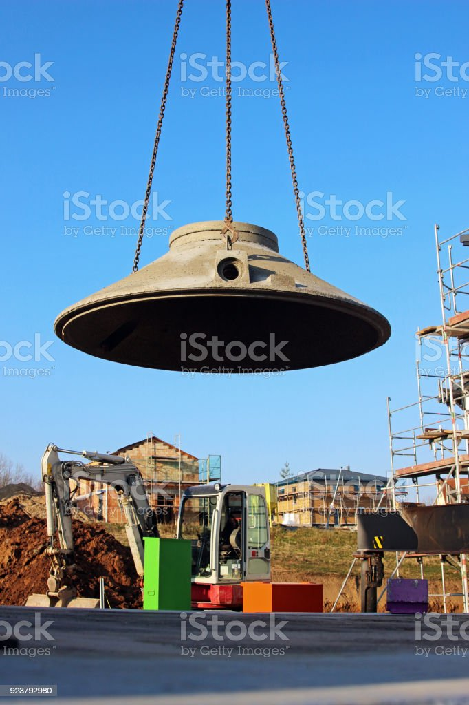 part of water cistern being lifted from truck stock photo