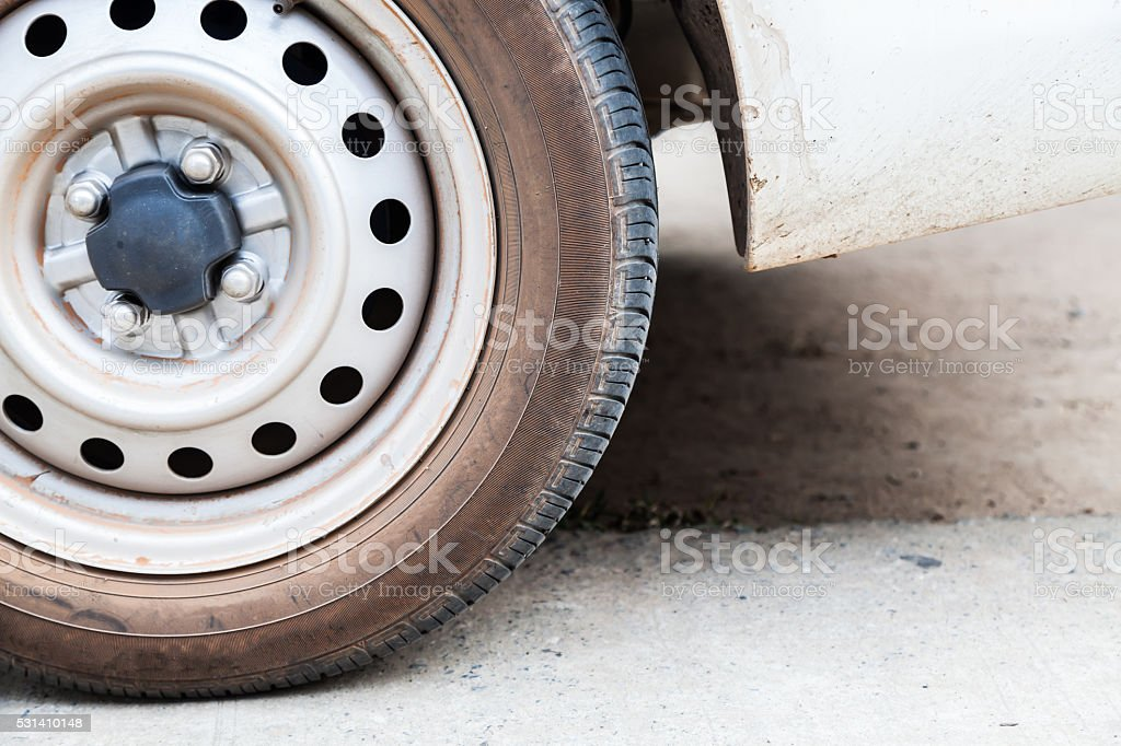 part of wheel car with old tires stock photo