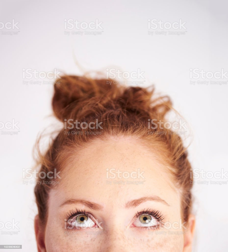 Part of young woman looking up at studio shot stock photo