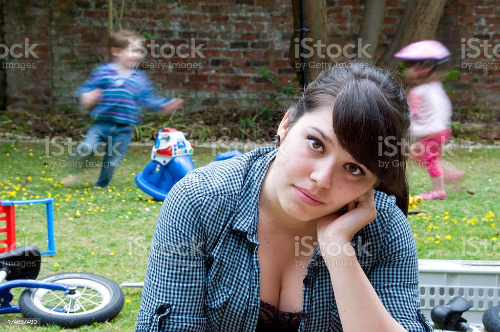 A part time nanny struggling to cope stock photo