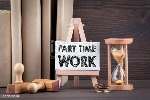 Part time work. Sandglass, hourglass or egg timer on wooden table showing the last second or last minute or time out